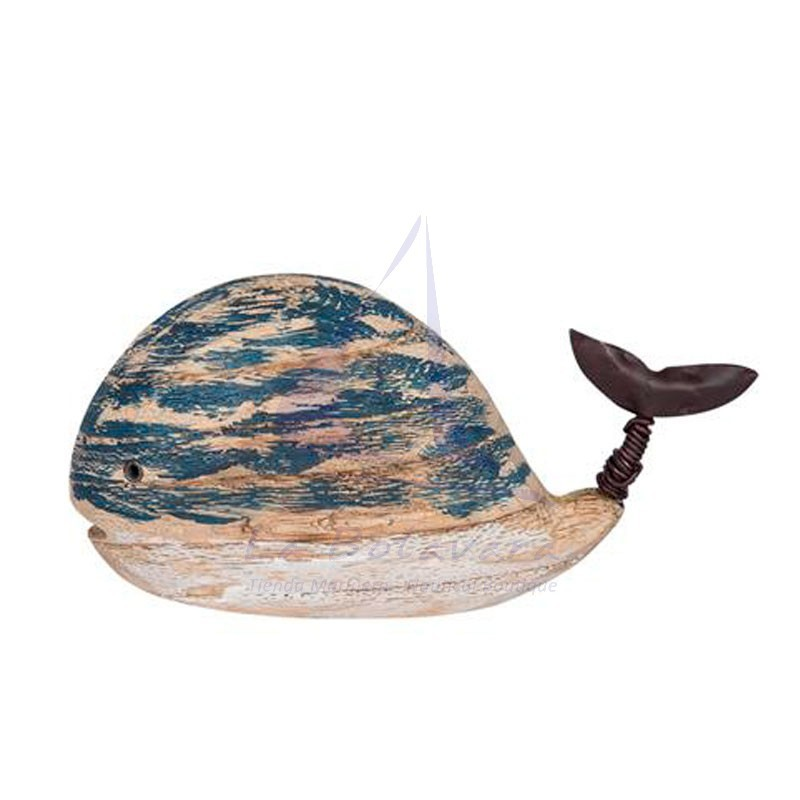 Navy blue wooden whale with metal tail